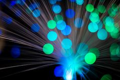 Abstract, intentionelly defocused lights on optical fibres. Technology background image royalty free stock photography
