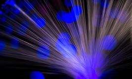 Abstract, intentionelly defocused lights on optical fibres. Technology background image stock photography