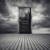 Abstract interior concept with black door and dramatic sky Stock Image