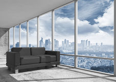 Abstract interior, office room with concrete floor. Window and black leather sofa, 3d illustration with big city landscape on a background Royalty Free Stock Photos