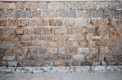 Abstract interior with rough stone wall Royalty Free Stock Photos