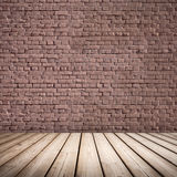 Abstract interior. Wooden floor and brick wall Royalty Free Stock Photography