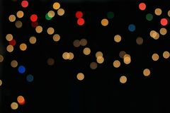 Night Lights - Color Background - Circles of Light and Beauty. Abstract interpretation as colorful night lights are photographed out of focus to create an image Stock Photos