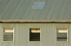 Abstract Iron. Corrigated iron shed with three windows Stock Image