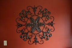 Abstract iron decor on red wall. Royalty Free Stock Photos
