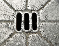 Abstract iron sewer hatch Royalty Free Stock Photo
