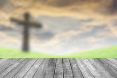 Abstract Jesus on the cross orange sky. With wooden paving royalty free stock photo