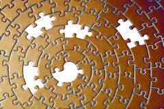 Abstract of a jigsaw in copper with five missing pieces Royalty Free Stock Photography