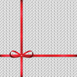 Abstract knitted pattern with red ribbon Royalty Free Stock Photography