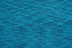 Abstract knitted texture of bright blue color Stock Image