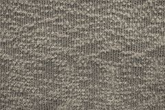 Abstract knitted texture of dark beige color Royalty Free Stock Images