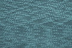 Abstract knitted texture of dark blue green color Royalty Free Stock Image