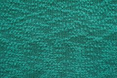 Abstract knitted texture of green emerald color Royalty Free Stock Images