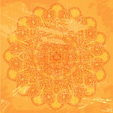 Abstract lace pattern on orange grunge background Stock Photo