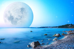 Abstract landscape with moon on sea cost Royalty Free Stock Photos