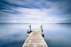 Halftone color. Abstract landscape. Wooden pier on Lake Zug in Switzerland. Long exposure Royalty Free Stock Photography