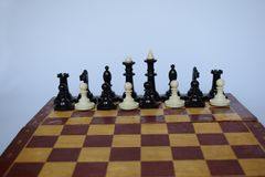 Abstract leadership business concept with chess pieces on a white background. The abstract position of figures on the chessboard, associated with a foreign Stock Images