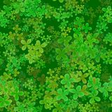 Abstract leafy pattern, Green leaves on dark background, Cloverleaf spring texture, Seamless four leaf clover illustration. Abstract leafy spring pattern, Green Stock Photo