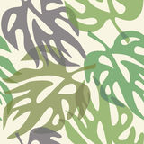 Abstract leaves on a seamless pattern wallpaper Stock Photos