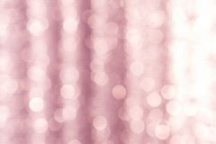 Abstract licht bokeh over vage roze achtergrond Royalty-vrije Stock Foto