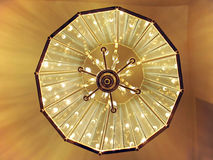 Abstract Light. View of a chandelier from the bottom royalty free stock image