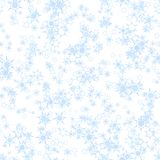 Abstract light blue snowflake pattern on white background.  Winter texture. Seamless illustration. Stock Image