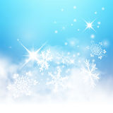 Abstract Light Blue Winter Background with Snowflakes and Starle Stock Photo