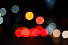 Abstract Light Bokeh Background.Blur picture of defocus light at night. Abstract night traffic bokeh background with defocused lights Royalty Free Stock Image