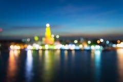 Abstract light bokeh of Wat Arun Temple with Chaophraya river- Bangkok stock photography