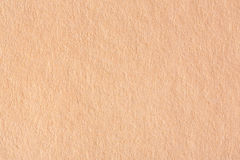 Abstract light brown paper background. High res macro photo Stock Image