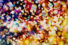 Festive Christmas background. Elegant abstract background with bokeh defocused lights and stars. Abstract light celebration background with defocused golden Stock Photos