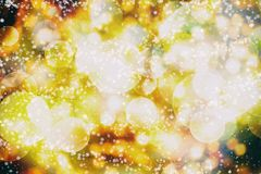 Festive Christmas background. Elegant abstract background with bokeh defocused lights and stars. Abstract light celebration background with defocused golden Stock Photo