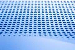 Abstract light colored surface with holes built in a row for creativity, wallpapers and backgrounds. Royalty Free Stock Image