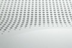 Abstract light colored surface with holes built in a row for creativity, wallpapers and backgrounds. Royalty Free Stock Photography