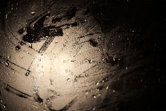 Abstract light effects on a wet glass pane with water drops Royalty Free Stock Photos