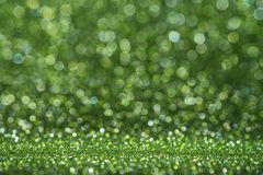 Abstract light green sparkling glitter wall and floor perspective background studio with blur bokeh.luxury holiday backdrop mock. Up for display of product stock image