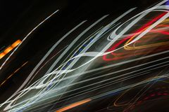 Abstract light line background. Colorful Light trails on dark background. stock image