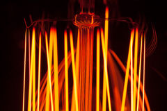 Abstract light spirals of bulb lamp stock photography