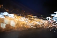 Abstract light trails at dark stock image