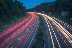 Abstract light trails. Light trails on UK motorway from commuter traffix on a summers evening Stock Photos