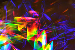 Abstract lighting trace. Abstract spectrum colored reflection on the pile of dvd disks Royalty Free Stock Photos