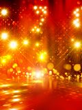 Abstract lights. Abstract background - bright yellow lights with reflection Stock Image