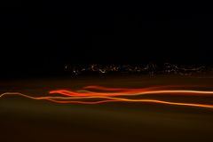 Abstract lights. On the night road royalty free stock images