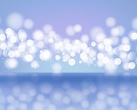 Abstract lights of bokeh on blue background. Blurred defocused lights in light blue colors. Royalty Free Stock Photography