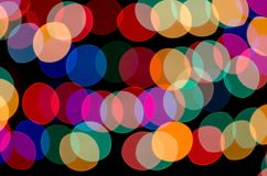 Circles of irregular shapes of different colors on a black background. Abstract lights. Circles of irregular shapes of different colors on a black background Royalty Free Stock Photo