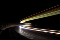 Abstract Lights In A Car Tunnel In White, Green,  Orange