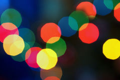 Abstract Lights RGB. Red Green Blue blurred out of focus light dots on a black and blue background stock photos