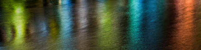 Abstract lights and water pattern. Abstract multicolour lights pattern created on a river surface stock photo