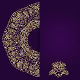 Abstract lilac background with gold lacy mandala pattern. Royalty Free Stock Image