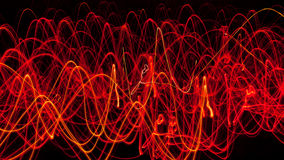 Abstract lines of fire. Many small light sources with long exposure produce this abstract wavy pattern Royalty Free Stock Photos